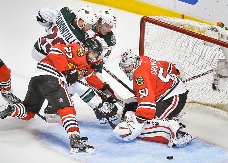 . Minnesota Wild right wing Jason Pominville and center Mikael Granlund are blocked from the puck by Chicago Blackhawks defenseman Johnny Oduya as goalie Corey Crawford defends during the third period. (Pioneer Press: Ben Garvin)