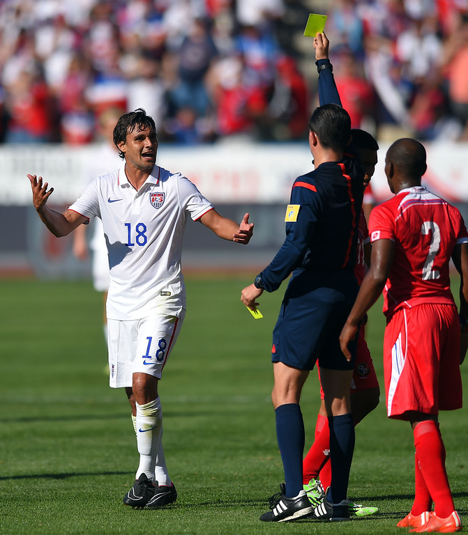 . USA�s Chris Wondolowski asks referee Henry Bejarano why he�s getting a yellow card after a pushing match with Panama�s Leonel Parris, right, at the StubHub Center in Carson, CA on Sunday, February 8, 2015. US men\'s national team beat Panama 2-0 in an international friendly soccer match. 2nd half. (Photo by Scott Varley, Daily Breeze)