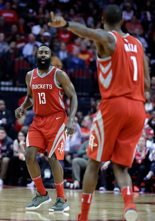 . Houston Rockets guard James Harden (13) celebrates a 3-point shot to forward Trevor Ariza (1) during the second half of an NBA basketball game against the Cleveland Cavaliers on Thursday, Nov. 9, 2017, in Houston. (AP Photo/Michael Wyke)
