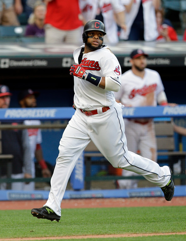 . Cleveland Indians\' Carlos Santana scores on a one-run double hit by Jose Ramirez in the fourth inning of a baseball game against the Oakland Athletics, Tuesday, May 30, 2017, in Cleveland. (AP Photo/Tony Dejak)