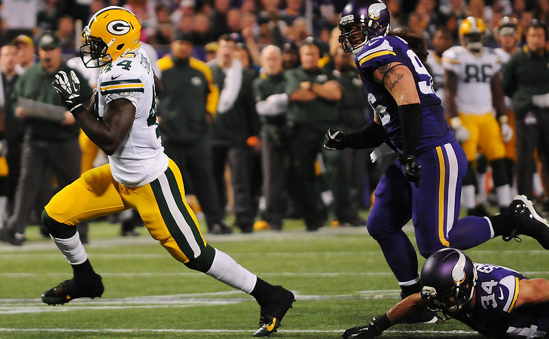 . Green Bay running back James Starks leaves Minnesota defensive end Brian Robison (96) and strong safety Andrew Sendejo (34) behind on the way to score a touchdown in the fourth quarter. (Pioneer Press: John Autey)