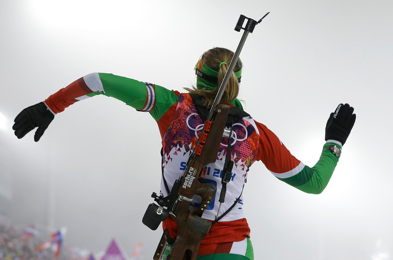 . Belarus\' Darya Domracheva dances in celebration after winning the gold in the women\'s biathlon 10k pursuit, at the 2014 Winter Olympics, Tuesday, Feb. 11, 2014, in Krasnaya Polyana, Russia. (AP Photo/Kirsty Wigglesworth)