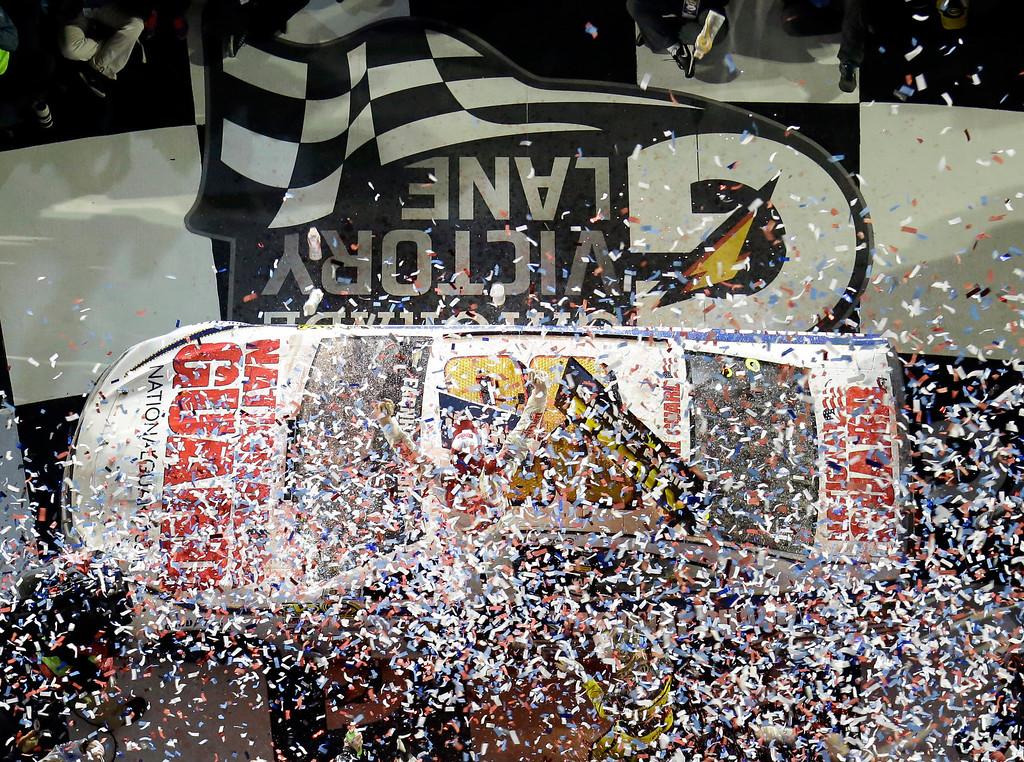. Dale Earnhardt Jr. celebrates in Victory Lane after winning the NASCAR Daytona 500 Sprint Cup series auto race at Daytona International Speedway in Daytona Beach, Fla., Sunday, Feb. 23, 2014. (AP Photo/John Raoux)