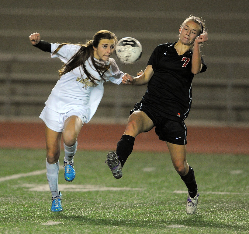 . TORRANCE - 02/12/2013 - (Staff Photo: Scott Varley/LANG) West High girls soccer beat Murrieta Valley on penalty kicks in their CIF Southern Section Division II wild-card matchup. After a 0-0 tie, West won 3-1 on PKs. West\'s Jessica Vincent, left, heads the ball away from Hayden Kelley.