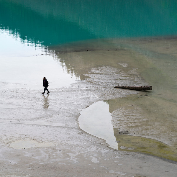 Person walking at lakeside, Lake Louise, Banff National Park, Alberta, Canada