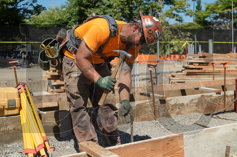 Jambavan Zakheim, a journeyman carpenter with Local 1503 and RDF Builders, constructs foundation formwork. (Josh Kulla/DJC)