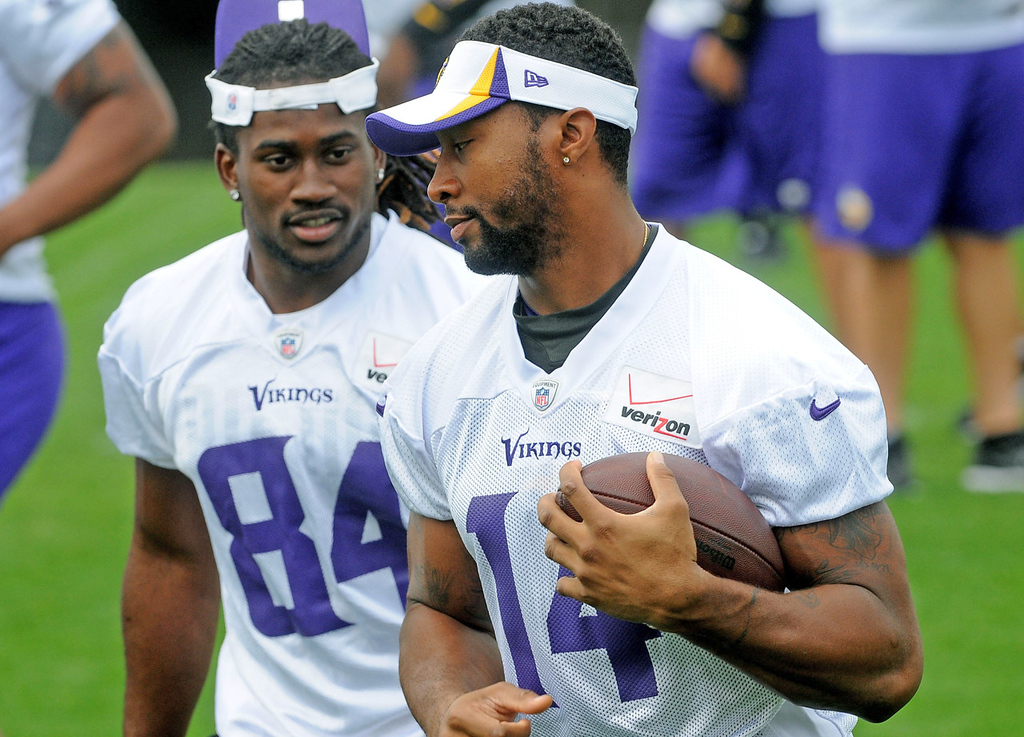 . Vikings wide receivers Joe Webb, left and Cordarrelle Patterson chat while running through a play during morning practice.  (Pioneer Press: Sherri LaRose-Chiglo)
