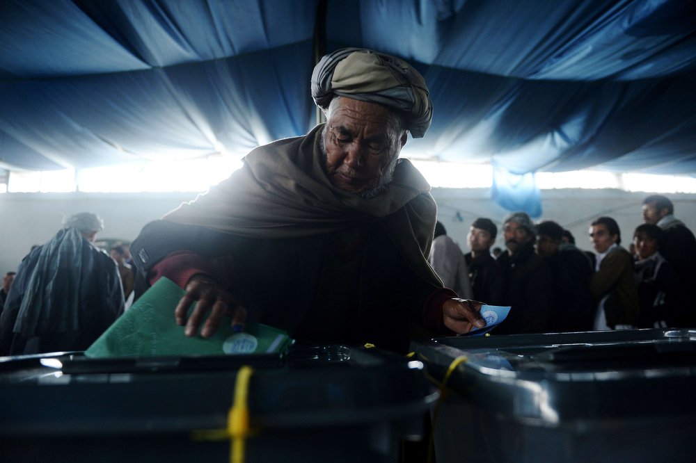 . An Afghan man casts his vote at a local polling station in Kabul on April 5, 2014. Afghan voters went to the polls to choose a successor to President Hamid Karzai, braving Taliban threats in a landmark election held as US-led forces wind down their long intervention in the country.   (SHAH MARAI/AFP/Getty Images)