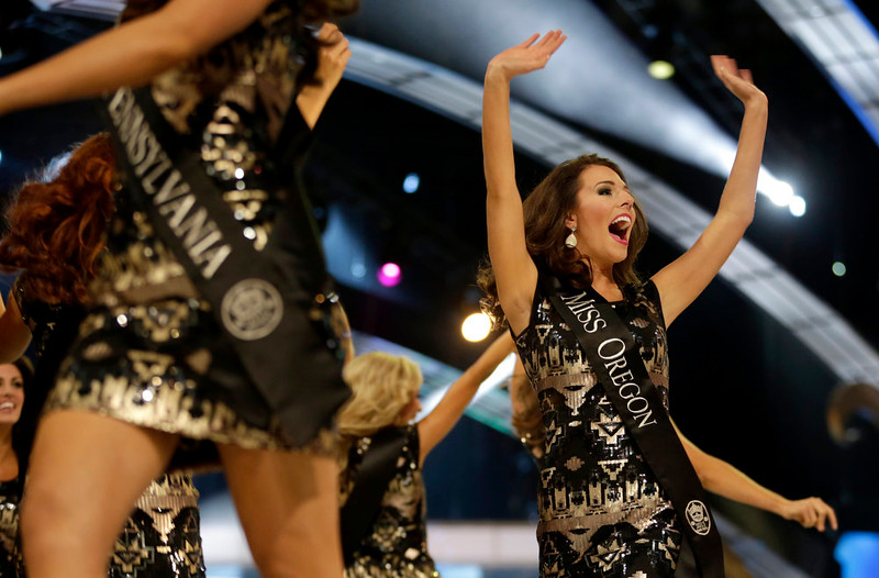 . Miss Oregon Rebecca Anderson takes the stage with contestants during the Miss America 2015 pageant, Sunday, Sept. 14, 2014, in Atlantic City, N.J. (AP Photo/Julio Cortez)