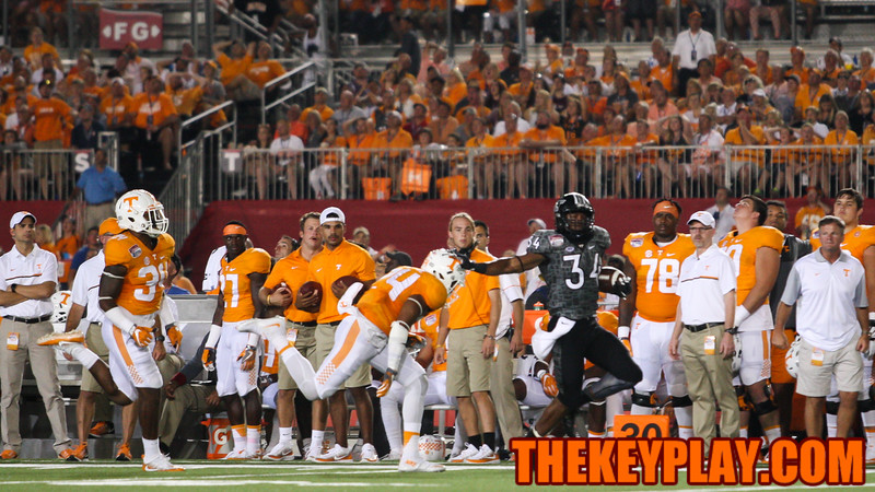 RB Travon McMIllian holds off Todd Kelly Jr. on a 69 yard touchdown run in the first quarter. (Mark Umansky/TheKeyPlay.com)