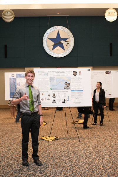 Jackson Konestski poses in front of his presentation during the McNair Poster Presentation.