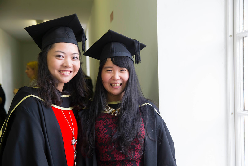 29/10/2015. FREE TO USE IMAGE. WIT (Waterford Institute of Technology) conferring ceremony at WIT College Street Campus, Waterford. Pictured are Fei Kang (Limerick) and Yunqi Jing (Waterford). Picture: Patrick Browne