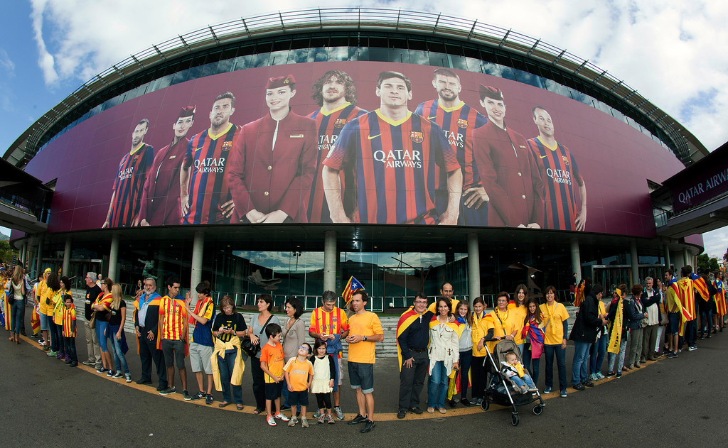 . Catalans wait prior to creating a 400-kilometre (250-mile) human chain, part of a campaign for independence from Spain during Catalonia National Day, or Diada, outside FC Barcelona\'s Camp Nou stadium in Barcelona, on September 11, 2013. Independence-seeking Catalans  marshaled their forces today to make a human link they say will stretch across 86 cities, towns and villages along the coast of the northeastern region on the Mediterranean, passing landmarks such as the Sagrada Familia basilica in Barcelona and the city\'s Camp Nou football stadium. QUIQUE GARCIA/AFP/Getty Images