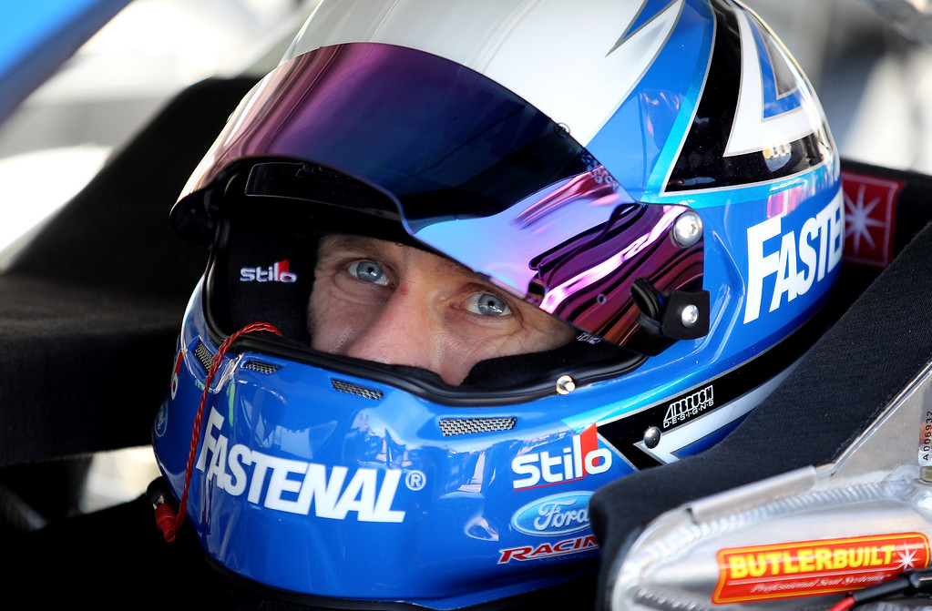 . DAYTONA BEACH, FL - FEBRUARY 20:  Carl Edwards, driver of the #99 Fastenal Ford, sits in his car in the garage during practice for the NASCAR Sprint Cup Series Daytona 500 at Daytona International Speedway on February 20, 2013 in Daytona Beach, Florida.  (Photo by Todd Warshaw/Getty Images)