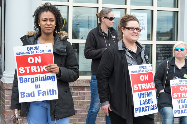 04/11/19 Wesley Bunnell | Staff Striking Stop & Shop workers Amber White, L and Heather Saumure stand with fellow workers near the entrance to the store in New Britain on Thursday afternoon.
