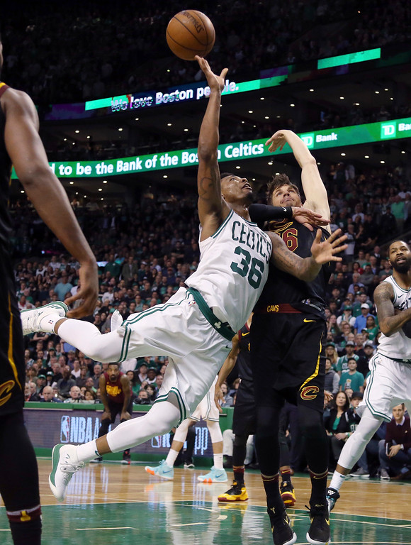 . Boston Celtics guard Marcus Smart loses the ball as he drives against Cleveland Cavaliers guard Kyle Korver, right, during the second half in Game 7 of the NBA basketball Eastern Conference finals, Sunday, May 27, 2018, in Boston. (AP Photo/Elise Amendola)