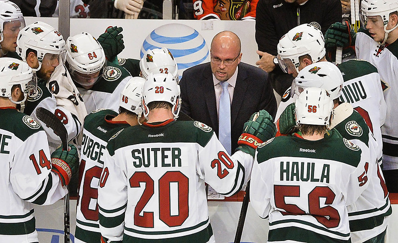 . Minnesota Wild head coach Mike Yeo talks to his players during a timeout in the third period.(Pioneer Press: Ben Garvin)