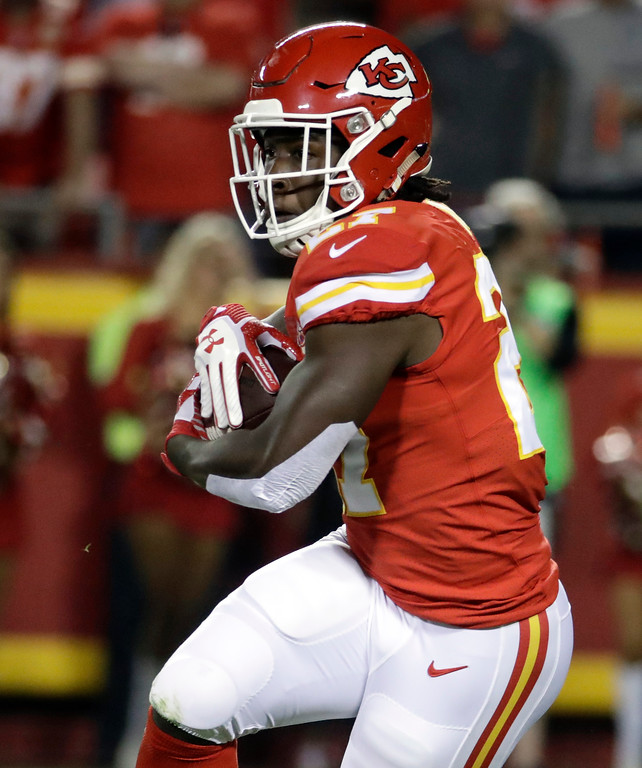 . Kansas City Chiefs running back Kareem Hunt carries the ball during the first half of an NFL football game against the Washington Redskins in Kansas City, Mo., Monday, Oct. 2, 2017. (AP Photo/Charlie Riedel)