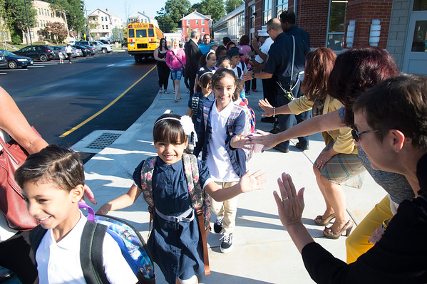 09/03/19 Wesley Bunnell | StaffrrStudents high five city officials , school administrators and firefighters as they arrive at Smalley School for their first day of school on Tuesday September 3, 2019.