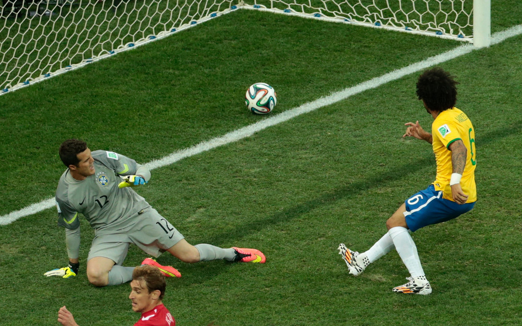 . Brazil\'s Marcelo, right, scores an own goal during the group A World Cup soccer match between Brazil and Croatia, the opening game of the tournament, in the Itaquerao Stadium in Sao Paulo, Brazil, Thursday, June 12, 2014.  (AP Photo/Shuji Kajiyama)