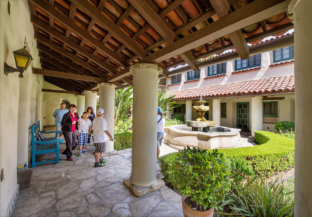 """. Carol Hamilton giving a tour of La Casa Nueva, or \""""the new house.\"""" Built between 1922 and 1927, this 12,400-square-foot Spanish Colonial Revival mansion is noted for its fine architectural crafts, including stained glass, ceramic tile, wrought iron, and carved wood. La Casa Nueva, or \""""the new house.\"""" The Homestead Museum will honor seven of its volunteers, all local La Puente and Hacienda Heights residents, at its annual Volunteer Appreciation Dinner on Sat., April 6. The volunteers have given more than 4,700 hours of their time to the museum giving tours of the historic homes and properties as well as during the museum\'s festivals, workshops, youth programs and more. The volunteers to be honored are well trained docents with several years of experience. Carol Hamilton (1,000 hrs) and Eldon Dunn (6,000 hrs) of Hacienda Heights. (SGVN/Photo by Walt Mancini/Highlanders)"""