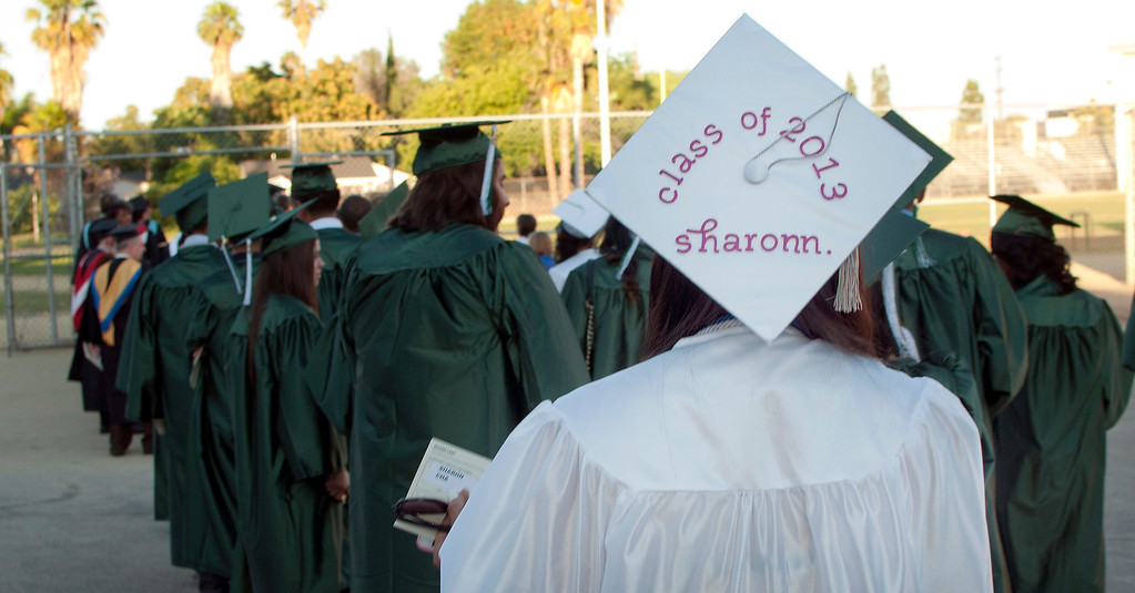 . Seniors line up before entering the football field.  The Canoga Park High School graduation class held their commencement in the school football field on Monday, June 10, 2013 in Canoga Park, CA.(Carlos Carpio/Special to the L.A. Daily News)