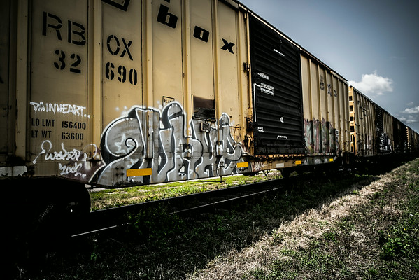 Abandoned rail cars and house