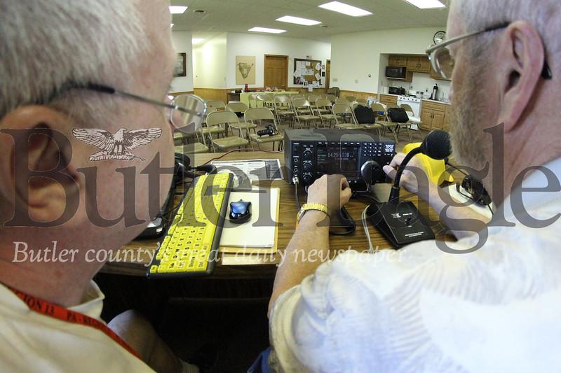 Julian Savage (left) Tom McCracken operate one of four ham radio control centers. Seb Foltz/Butler Eagle