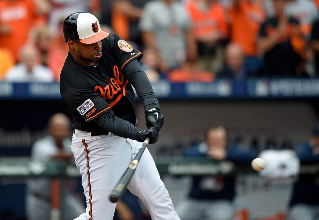 . Baltimore Orioles\' Delmon Young hits a three-run double in the eighth inning of Game 2 in baseball\'s AL Division Series against the Detroit Tigers in Baltimore, Friday, Oct. 3, 2014. Baltimore won 7-6. (AP Photo/Nick Wass)