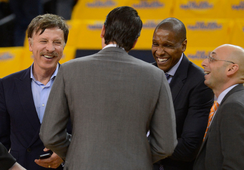 . Stan Kroenke (L) with President and Governor Josh Kroenke  and Executive Vice President of Basketball Operations Masai Ujiri and Vice President of Basketball Operations: Pete D\'Alessandro during the teams pre game shoot around. The Denver Nuggets take on the Golden State Warriors in Game 6 of the first round NBA Playoffs May 2, 2013 at Oracle Arena. (Photo By John Leyba/The Denver Post)