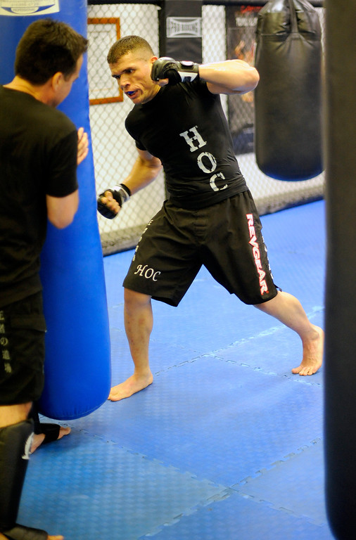 . Head instructor Mark Parra trains UFC Fighter Eddie Mendez at the House of Champions in Van Nuys. (Hans Gutknecht/Los Angeles Daily News)