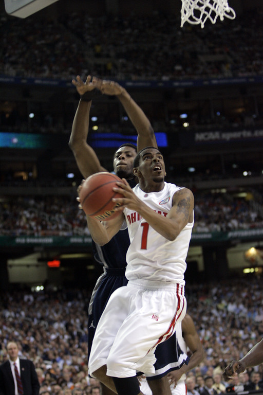 . Ohio State\'s Mike Conley Jr, front, takes a shot as Georgetown\'s Patrick Ewing Jr. attempts to block during their men\'s semifinal basketball game at the Final Four in the Georgia Dome in Atlanta Saturday, March 31, 2007. (AP Photo/Gerry Broome)