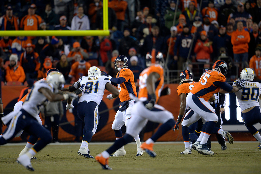 . Denver Broncos quarterback Peyton Manning (18) looks down field during the forest drive of the game. The Denver Broncos vs. the San Diego Chargers at Sports Authority Field at Mile High in Denver on December 12, 2013. (Photo by Joe Amon/The Denver Post)