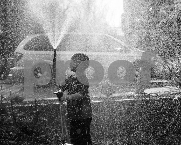 Kid with a hose_bw_web_2048-1000086.jpg