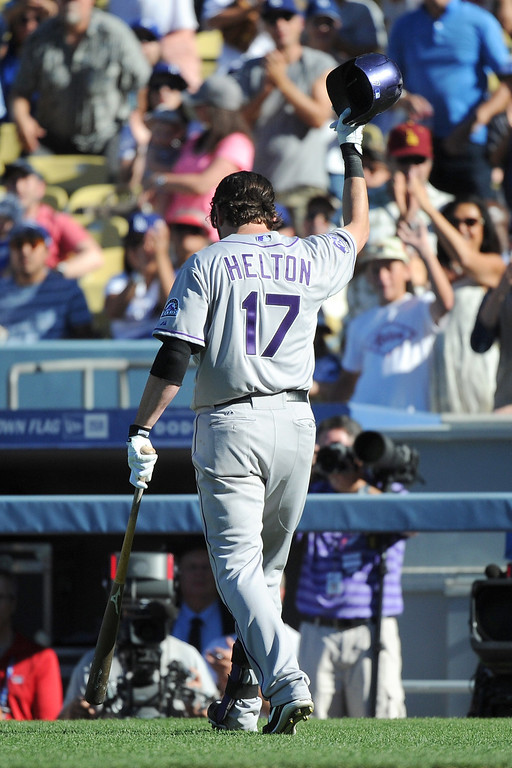 . LOS ANGELES, CA - SEPTEMBER 29:  Todd Helton #17 of the Colorado Rockies acknowledges the crowd in the ninth inning against the Los Angeles Dodgers at Dodger Stadium on September 29, 2013 in Los Angeles, California.  Helton is retiring at the ens of the 2013 season.  (Photo by Lisa Blumenfeld/Getty Images)