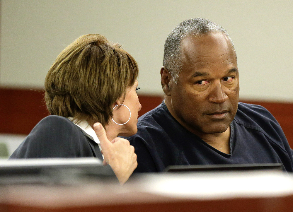 . O.J. Simpson (R) talks with his attorney, Patricia Palm during his retrial in Clark County District Court May 13, 2013 in Las Vegas, Nevada. Simpson, who is currently serving a nine to 33-year sentence in state prison as a result of his October 2008 conviction for armed robbery and kidnapping charges, is using a writ of habeas corpus, to seek a new trial, claiming he had such bad representation that his conviction should be reversed.  (Photo by Julie Jacobson - Pool/Getty Images)