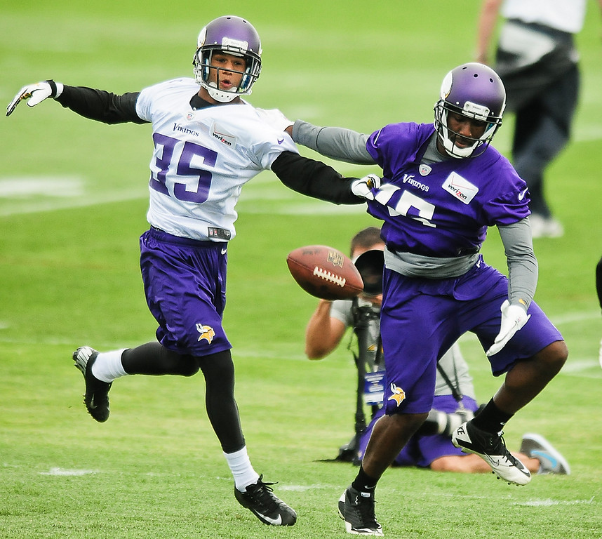 . Minnesota Vikings cornerback Marcus Sherels, left, breaks up a pass intended for wide receiver Greg Jennings at Vikings training camp in Mankato, Minn., on Friday, July 26, 2013. (Pioneer Press: Ben Garvin)
