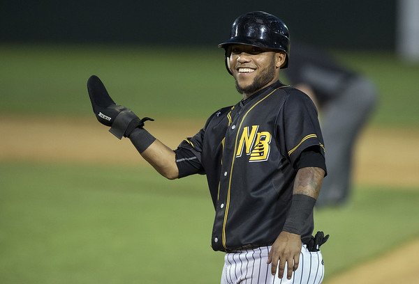 The New Britain Bees defeated the Sugarland Skeeters 6-1 on June 21, 2019. Alexi Amarista (2) smiles after teammates yell to him standing on first base. | Wesley Bunnell | Staff