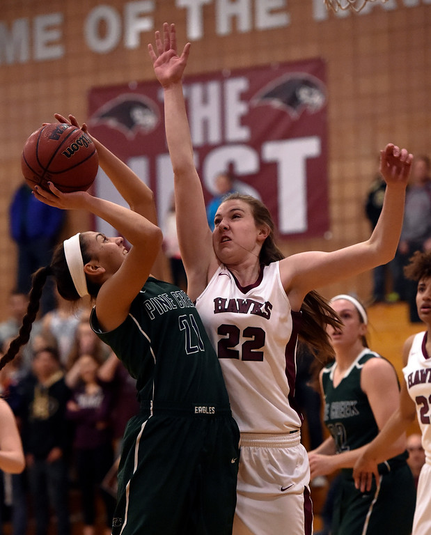 . THORNTON, CO - MARCH 01: Pine Creek Jade Odom (21) takes a shot over Horizon Samantha Deem (22) during the Girls Class 5A Sweet 16 game March 1, 2016 at Horizon HS. (Photo By John Leyba/The Denver Post)