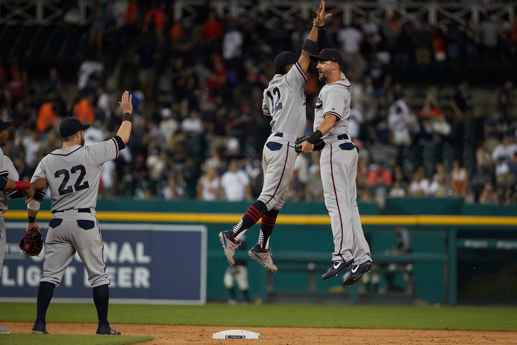. Cleveland Indians second baseman Jason Kipnis, left, shortstop Francisco Lindor, center, and right fielder Lonnie Chisenhall, right, celebrate after the second baseball game of a doubleheader against the Detroit Tigers in Detroit, Saturday, July 1, 2017. (AP Photo/Rick Osentoski)