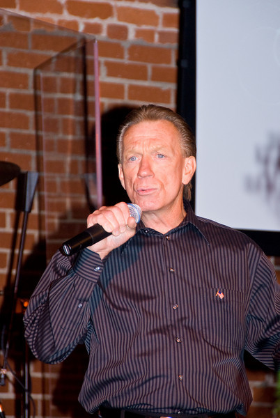 Photo from Taste of 210 Event 4-26-2008This is a fundraising event in suport of 210 community project.Doug Scarborough sang three beautiful songs for us.  Doug is married to the daughter of the Janigian's who ran the toy store in this building in the 1970's.