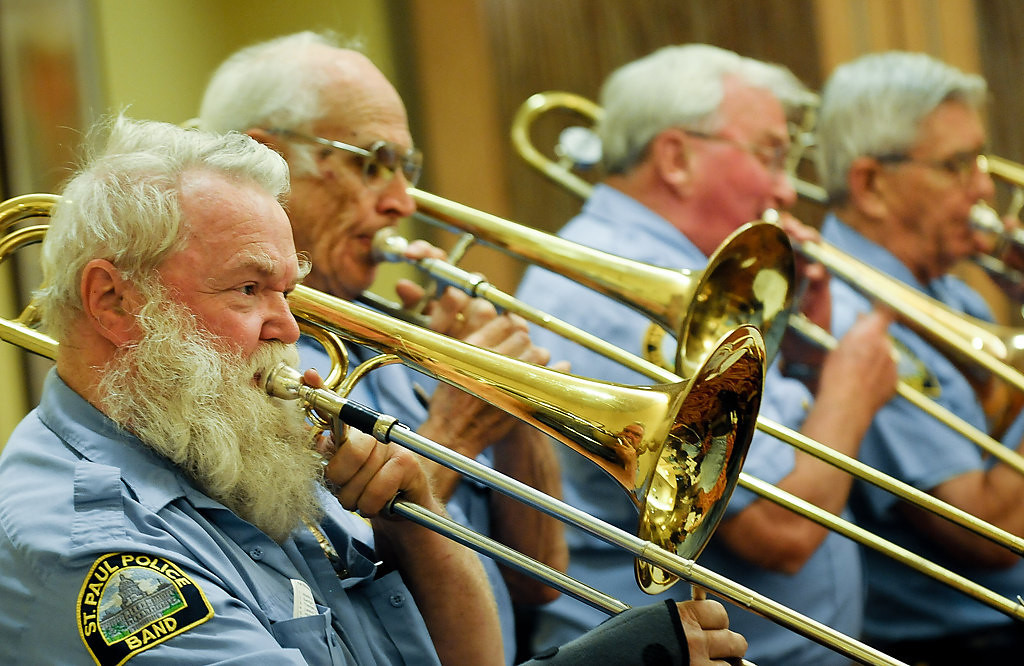 . Cliff Rude of Minneapolis, left, and other trombone players perform. (Pioneer Press: Ben Garvin)