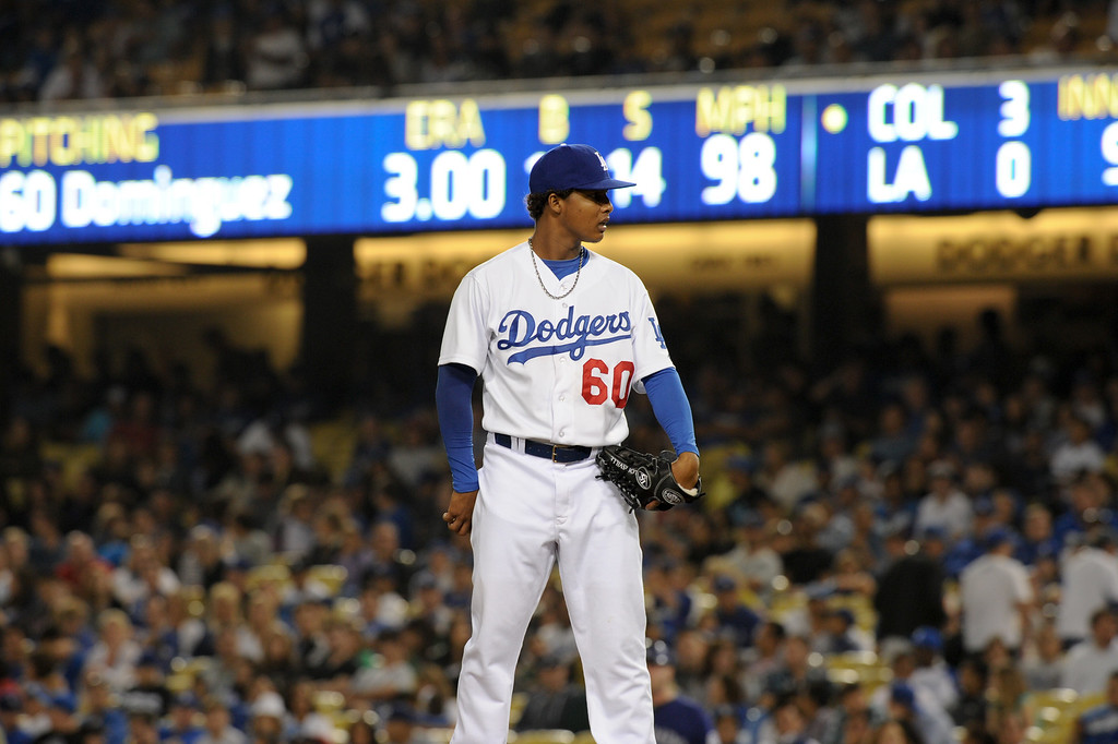 . The scoreboard shows Dodger reliever Jose Dominguez\' pitch at 98 mph against the Rockies, Friday, July 12, 2013, at Dodger Stadium. (Michael Owen Baker/Staff Photographer)