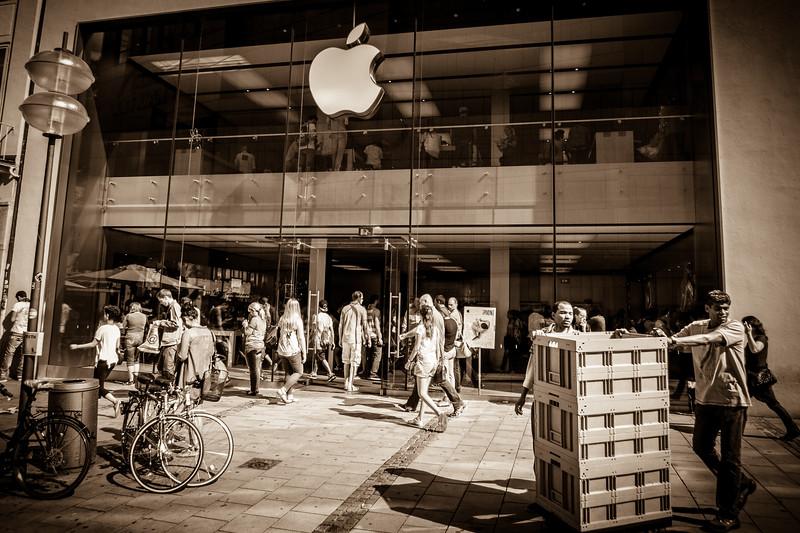 Street life scene around the Apple Store at Rosenstrasse.