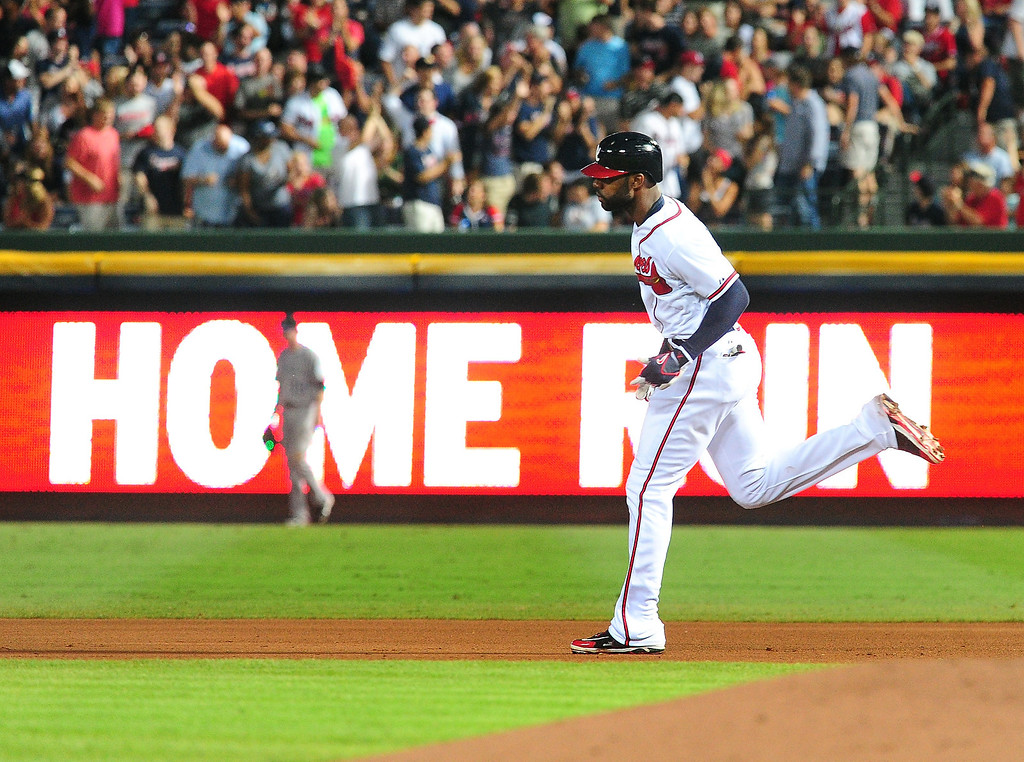 . Jason Heyward #22 of the Atlanta Braves rounds the bases after hitting a fourth inning two run home run against the Colorado Rockies at Turner Field on August 1, 2013 in Atlanta, Georgia. (Photo by Scott Cunningham/Getty Images)