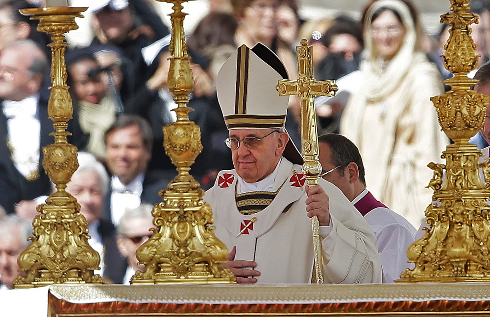 . Pope Francis walks past the alter in front of St. Peter\'s Basilica in St. Peter\'s Square following his inauguration Mass at the Vatican, Tuesday, March 19, 2013.  (AP Photo/Gregorio Borgia)