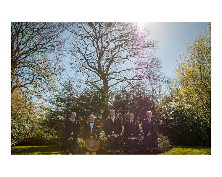 Wedding Photography of Sarah & Brian, Grange Manor Hotel, Grangemouth, Falkirk, Photograph is of the Groom & Groomsmen in front of trees in the sun