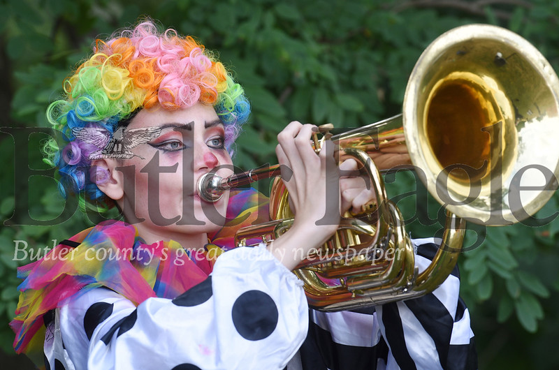 Harold Aughton/Butler Eagle: Ryan Nesbitt, a rising 9th grader, decided to dress up like a clown during circus day at the Mars High School's band camp. He is playing the baratone.