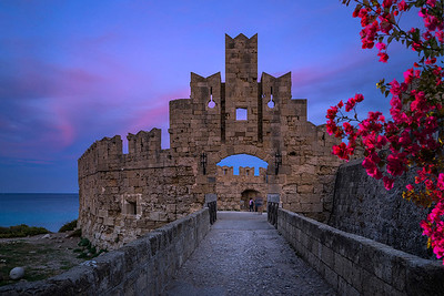 The fortress wall in the harbor at sunset. Rhodes