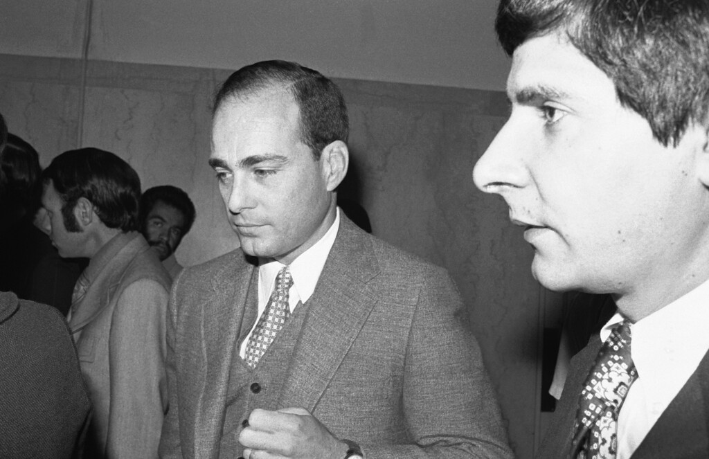 ". Deputy District Attorney Vincent Bugliosi arrives at a Los Angeles courtroom July 24, 1970, to present the opening argument in the trial of Charles Manson and three others for the slayings of actress Sharon Tate and six others in Los Angeles. He said a song by the Beatles inspired Manson to order the slayings in order to start a ""black-white revolution.\"" (AP Photo/Wally Fong )"